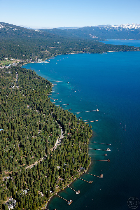 """Lake Tahoe Aerial 4""- Photograph of the shoreline at Lake Tahoe, Tahoe City can be seen in the distance. Shot from an amphibious seaplane with the door removed."