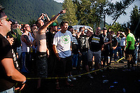 The crowd gathers to watch young women perform in the wet t-shirt contest at the Testicle Festival in Clinton, MT. Most participants in the wet t-shirt contest removed all of their clothing while performing for the crowd.  The Rock Creek Lodge in Clinton, MT, has hosted the annual Testicle Festival since the early 1980s.  The four day festival and party revolves around the consumption of so-called Rocky Mountain Oysters, which are deep-fried bull testicles.