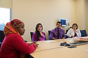 Bisharo Kasim, a Somali Bantu and interpreter, (in red sweater) meets with medical students KAtia Chavez and Nicholas Monte and Jan Gallant, M.D.