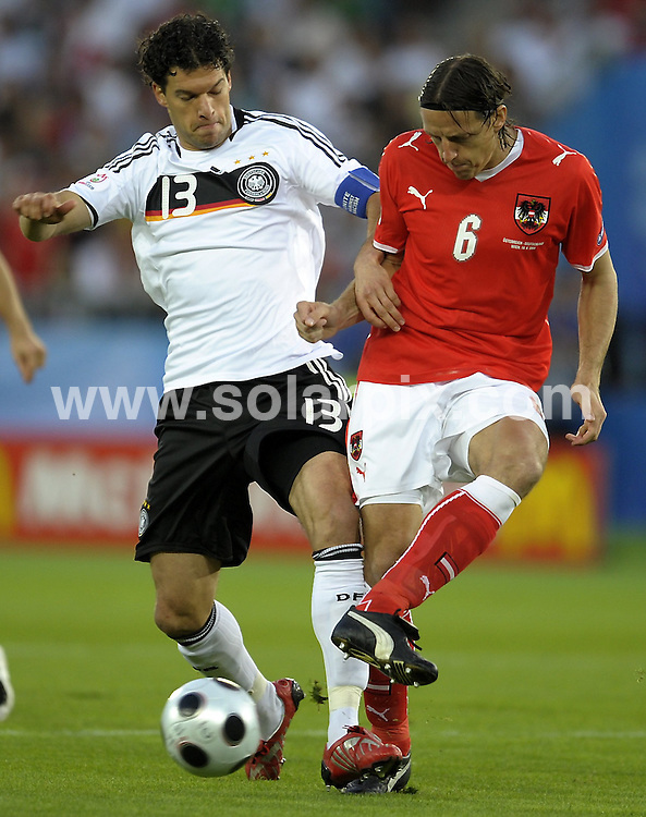 **ALL ROUND PICTURES FROM SOLARPIX.COM**.**SYNDICATION RIGHTS FOR UK AND SPAIN ONLY**.Euro 2008, European Football Championship 2008, held in Austria & Switzerland, Group B, Match 20, Austria vs Germany, at the Ernst Happel Stadium, Vienna, Austria, 16 June 2008..This pic: Michael Ballack and Rene Aufhauser..JOB REF: 6655 CPR/Torsten Silz        .DATE: 16_06_2008.**MUST CREDIT SOLARPIX.COM OR DOUBLE FEE WILL BE CHARGED* *UNDER NO CIRCUMSTANCES IS THIS IMAGE TO BE REPRODUCED FOR ANY ONLINE EDITION WITHOUT PRIOR PERMISSION*
