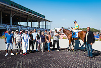 OLDSMAR, FL - JANUARY 21: The Money Monster #3 (blue cap), ridden by Edgard J. Zayas, in the winners circle after winning the Pasco Stakes on Skyway Festival Day at Tampa Bay Downs on January 21, 2017 in Oldsmar, Florida. (Photo by Douglas DeFelice/Eclipse Sportswire/Getty Images)