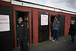 Prescot Cables 2 Brighouse Town 1, 13/02/2016. Hope Street, Northern Premier League. Spectators arriving at the turnstiles before Prescot Cables played Brighouse Town in a Northern Premier League division one north fixture at Valerie Park. Founded in 1884, the 'Cables' in their name came from the largest local employer, British Insulated Cables and they have played in their current ground, also known as Hope Street, since 1906. Prescott won the match 2-1 watched by a crowd of 189. Photo by Colin McPherson.