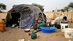 A woman prepares food in Timbuktu, a city in northern Mali which was seized by Islamist fighters in 2012 and then liberated by French and Malian soldiers in early 2013.  She belongs to the Bella ethnic group, which has traditionally been exploited by Timbuktu's lighter-skinned groups.
