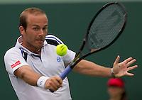 Olivier ROCHUS (BEL) against Novak DJOKOVIC (SRB)  in the second round of the men's singles. Rochus beat Djokovic 6-2 6-7 6-4 ..International Tennis - 2010 ATP World Tour - Sony Ericsson Open - Crandon Park Tennis Center - Key Biscayne - Miami - Florida - USA - Fri 26 Mar 2010..© Frey - Amn Images, Level 1, Barry House, 20-22 Worple Road, London, SW19 4DH, UK .Tel - +44 20 8947 0100.Fax -+44 20 8947 0117