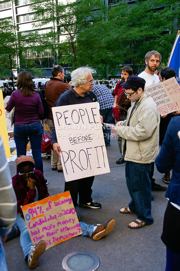 Protester holds &quot;People before profit&quot; sign at the Occupy Wall Street Protest in New York City October 6, 2011.