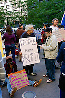 "Protester holds ""People before profit"" sign at the Occupy Wall Street Protest in New York City October 6, 2011."