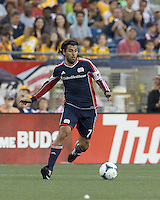 New England Revolution midfielder Juan Carlos Toja (7) at midfield.  In a Major League Soccer (MLS) match, the New England Revolution (blue) tied D.C. United (white), 0-0, at Gillette Stadium on June 8, 2013.