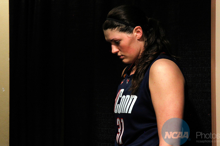 01 APRIL 2012:  Stefanie Dolson (31) of the University of Connecticut reflects on their loss to the University of Notre Dame during the Division I Women's Final Four Semifinals at the Pepsi Center in Denver, CO.  Notre Dame defeated UCONN 83-75 to advance to the national championship game.  Jamie Schwaberow/NCAA Photos