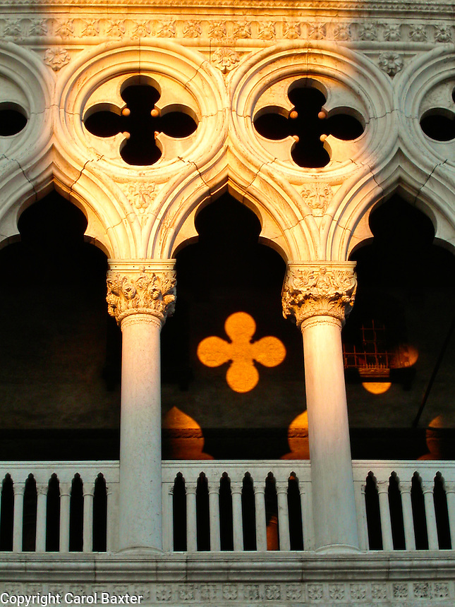 Shadows from the setting sun highlight the architecture of the Doge's Palace (Palazzo Ducale) in Piazza San Marco, Venice, Italy.