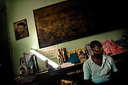 A Cuban man stands behind the shop counter under a portrait of the revolutionary leader Che Guevara, hung on the wall of a shop, in Havana, Cuba, 16 August 2008. During the Cuban Revolution, an armed rebellion at the end of the 1950s in Cuba, most of the revolutionary leaders started as no-name soldiers fighting in the jungle. Although the revolutionary leaders, after taking over the power, became autocratic rulers holding almost absolute power and putting the opposition in jail, for some reason Cuban people have never stopped to worship Fidel Castro, Che Guevara, Raul Castro and others. Cubans hang their photos and portraits on the wall in homes, shops and working places even they don't have to. The people of Cuba love their heroes.