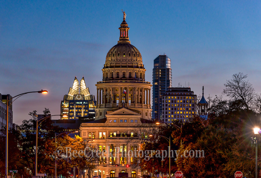 Anothet image of the Capitol skyline in downtown Austin at twilight.  We captured the State Capitol with the city skyline in the background with two promenient building the Frost and Austonian at dusk.  This was captured from the north side of congress as the sun was setting with only a slight glow over the city.  Behind the Capitol you can see the iconic Frost building along with Austin tallest building the Austonian.  The skyline in the city are constantly changing so you never know if you will see the same view of the skyline each time you photograph downtown.  The capitol is not suppose have taller buildings than itself within a certain area but things could change at any time.  This is one of my favorite view because you can really see the splendor of the building from here much better than the front because of the trees that line the front side of the building where they have grown up so much it hard to see the capitol.  I guess this is why I keep coming back to this location.   The capitol was built of red granite in 1888 and the style of architecture Renaissance Revival of the 15 century