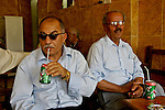 Kurdish men sit and drink soft drinks in a cafe in downtown Irbil, Iraq...Stability and security prevail in postwar Iraqi Kurdistan as Iraqi tourists, many of them from Baghdad, flock to the northern cities and their amusement parks and national parks to escape violence and sectarian strife in the central and southern regions of the country.