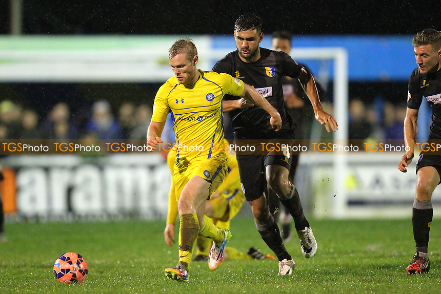 Stephen Cawley of Concord Rangers seeks to evade Ryan Tafazolli of Mansfield Town - Concord Rangers vs Mansfield Town - FA Challenge Cup 1st Round Replay Football at the Aspect Arena, Thames Road, Canvey Island, Essex - 25/11/14 - MANDATORY CREDIT: Gavin Ellis/TGSPHOTO - Self billing applies where appropriate - contact@tgsphoto.co.uk - NO UNPAID USE