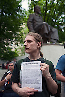 """Moscow, Russia, 12/05/2012..A protester under  the statue of Kazakh poet Abai Kunanbaev hold a sign """"Occupy Russia"""" in Chistiye Prudy, or Clean Ponds, a park in central Moscow were some 200 opposition activists have set up camp."""