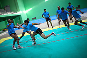 A raider aggressively reaches out to the defendant team-members during the kabbadi training sessions as part of the training at a month long camp for the Indian national Kabbadi team in Sport Authority of India Sports Complex in Bisankhedi, outskirts of Bhopal, Madhya Pradesh, India.