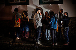 A group of students takes a smoke break outside a bar in Ouro Preto, Brazil.