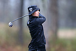 BROWNS SUMMIT, NC - MARCH 31: UNCG's Kendall Dobbins tees off on the 12th hole. The first round of the Bryan National Collegiate Women's Golf Tournament was held on March 31, 2017, at the Bryan Park Champions Course in Browns Summit, NC. A waterlogged course eventually suspended play.