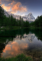 The Cervino - better known as Matterhorn outside Italy - and the tiny Lago Blu at sunset. Near to Breuil-Cervinia in Valtournenche, Valle d'Aosta, Italy. Taken at sunset on the solstice day of 2008.