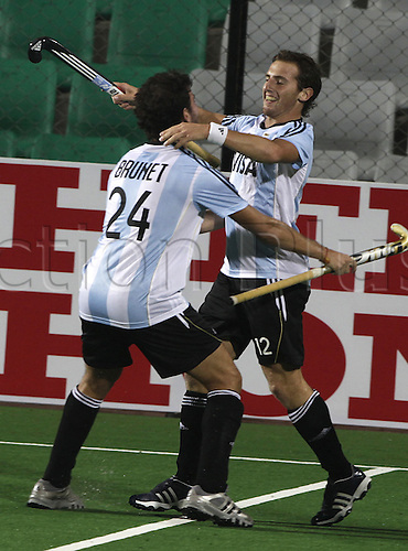 03.05.2010.Delhi,India.FIH World Cup Field Hockey.Germany verses Argentina. Argentina's Lucas Martin Vila center celebrates after scoring the first goal during their match against Germany at the men's Hockey World Cup in New Delhi. Photo:Pankaj Nangia/Actionplus - Editorial Use