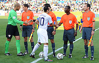 Landon Donovan (10) and Tim Howard (green) of USA shake hands with the match officials before the game. Brazil defeated USA 3-0 during the FIFA Confederations Cup at Loftus Versfeld Stadium in Tshwane/Pretoria, South Africa on June 18, 2009.