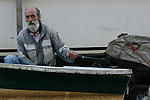 A Man steers a small boat in the river in the Tigre section or Buenos Aires, Argentina