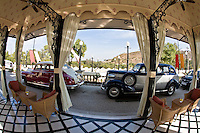 Waiting pavilion of the Taj Lake Palace with classic vintage cars parked.<br /> (Photo by Matt Considine - Images of Asia Collection)