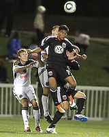 Andy Najar(14) of D.C. United heads away from Jordan Harvey(2) and Brian Carroll(7) of the Philadelphia Union during a play-in game for the US Open Cup tournament at Maryland Sportsplex, in Boyds, Maryland on April 6 2011. D.C. United won 3-2 after overtime penalty kicks.