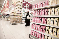 Qatar - Doha - Qatari woman shopping at carrefour