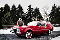 Reinholds, Pennsylvania, February 10, 2015 - A portrait of Brian Moyer with his fully restored 1971 AMC Gremlin Base Model outside his home in Reinholds, PA. <br /> <br /> Moyer owns 16 AMC Gremlins. The Gremlin was introduced on April Fools Day (April 1) in 1970 featuring a shortened Hornet body with a Kammback tail and was manufactured in the US via AMC and in Mexico via AMC's subsidiary VAM. It's lifecycle ended in 1978 when it was replaced by the AMC Spirit. Moyer became interested as a kid when he saw the early Gremlin commercials in 1970. His first car was a Gremlin and he has never not owned one. Today he has arguably the most unique collection of Gremlins in the world, including several that are one-of-a kind models. <br /> <br /> CREDIT: Daryl Peveto for The Wall Street Journal<br /> Photo Assignment ID: 36892 <br /> Slug: MYRIDE_Gremlin