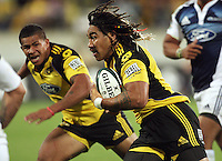 Hurricanes second five Ma'a Nonu runs with David Smith in support during the Super 14 rugby union match between the Hurricanes and Blues at Westpac Stadium, Wellington, New Zealand on Friday 1 May 2009. Photo: Dave Lintott / lintottphoto.co.nz