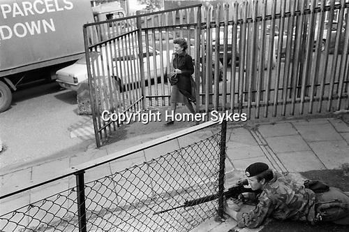 Derry Northern Ireland Londonderry. 1979. British soldiers on patrol at Butchers Gate
