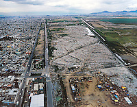 aerial view above Mexico City garbage dump in Nezahualoyotl in former Lake Texcoco basin