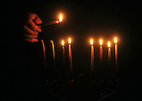 """Photo Illustration  NWA Democrat-Gazette/MICHAEL WOODS • The lighting of the menorah is a big part of Hanukkah, the 8-day Jewish festival of light.  Hanukkah celebrates religious freedom and the triumph of light over darkness. Hanukkah means """"dedication"""" and refers to the rededication of the Holy Temple in Jerusalem at the end of the war.  Hanukkah is observed for eight nights and days, starting on the 25th day of Kislev according to the Hebrew calendar."""
