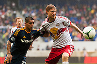 Rafael Garcia (25) of the Los Angeles Galaxy and Markus Holgersson (5) of the New York Red Bulls. The New York Red Bulls defeated the Los Angeles Galaxy 1-0 during a Major League Soccer (MLS) match at Red Bull Arena in Harrison, NJ, on May 19, 2013.