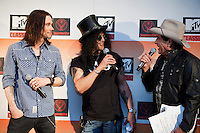 "Myles Kennedy, Slash and Ian ""Molly"" Meldrum at the media call for the MTV Classic launch at Maze Restaurant, Crown Metropole, Melbourne, 27 April 2010"