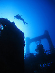 Orchid Island, Taiwan -- A diver hugging the silhouette of the Ba Dai ship wreck.
