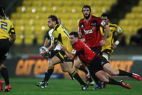 Ryan Crotty tackles Aaron Cruden. Super 15 rugby match - Crusaders v Hurricanes at Westpac Stadium, Wellington, New Zealand on Saturday, 18 June 2011. Photo: Dave Lintott / lintottphoto.co.nz