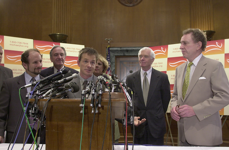 Fox M.2(DG)052300 -- Michael J. Fox along withPaul Wellstone, D-Minn., Tom Harkin, D-Iowa, Thad Cochran, R-Miss., and Arlen Specter, R-Pa., during a press conference on Parkinson's research.