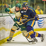 29 December 2013:  University of Vermont Catamount Forward Brendan Bradley, a Freshman from Warminster, PA, is checked by Carl Larsson during second period action against the Canisius College Golden Griffins at Gutterson Fieldhouse in Burlington, Vermont. The Catamounts defeated the Golden Griffins 6-2 to capture the 2013 Sheraton/TD Bank Catamount Cup NCAA Hockey Tournament for the second straight year. Mandatory Credit: Ed Wolfstein Photo *** RAW (NEF) Image File Available ***