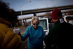 Evelyn Christian passes out soup to campers by the 12th Street bridge near the SafeGround camp in Sacramento, Calif., January 15, 2011.