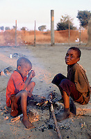 Angola. Cuando Cubango. Mavinga. Early morning, young boys are getting warm by the fire. The children are treated for malnutrition in the suplementary feeding center run by MSF (M?decins Sans Frontires) Switzerland.  © Didier Ruef