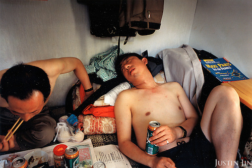 France, Paris, 05-2003..Illegal Chinese Mr Wang (R), 42, rests at home with his room mate in Paris. They are a new wave of immigrants from China?s northeast, home to millions of former cradle-to-grave factory workers laid off by closures. ..