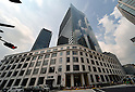 May 29, 2012, Tokyo, Japan - JP Tower, a 200-meter-tall office building of Japan Post Group, rises above the historic facade of the former Tokyo Central Post Office in the Marunouchi business district of Tokyo on Tuesday, May 29, 2012. ..With the completion of the tower at the end of May and the October grand opening of the restored Tokyo Central, there will be a significant change in the vista in front of the Imperial Palace. (Photo by Natsuki Sakai/AFLO)