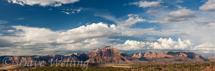 999400008 thunderstorms and clouds form over west temple and zion geological formations in this panoramic  view from a backcountry scenic byway near hurricane utah