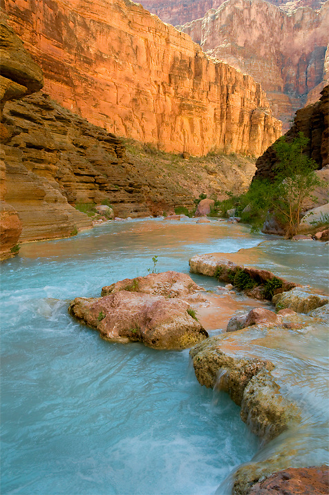 Brilliant blue Havasu creek is a wonderful place to stop and swim on a Grand Canyon river trip.