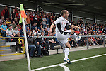 Fulham captain Danny Murphy taking a corner in front of Crusaders fans during the first half of a UEFA Europa League 2nd qualifying round, fist leg match at Seaview, Belfast. The visitors from England won by 3 goals to 1 before a crowd of 3011.