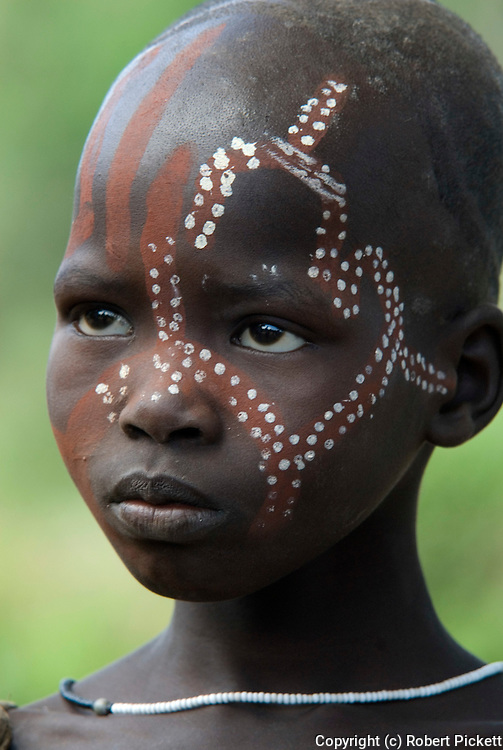 Young Boy with face painted, Mursi Tribe, Mago National Park, Lower Omo Valley, Ethiopia, portrait, person, one, tribes, tribal, indigenous, peoples, Southern, ethnic, rural, local, traditional, culture, primitive,.Africa....