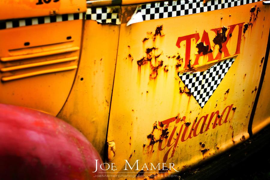 Door of an aged Tijuana Taxi cab.