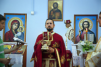 Italy. Lazio region. Guidonia. Father Sebastian is an orthodox priest and a romanian citizen. He prays during the sunday mass. Icon of the Lord Jesus and the Vigin Mary holding Jesus in her arms. Romanian immigration. Guidonia is a town and comune in the province of Rome. 02.10.2011 © 2011 Didier Ruef