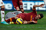 Calcio, Serie A: AS Roma vs Torino. Roma, stadio Olimpico, 19 novembre 2012..AS Roma midfielder Marquinho, of Brazil, falls on the pitch during the Italian Serie A football match between AS Roma and Torino at Rome's Olympic stadium, 19 November 2012..UPDATE IMAGES PRESS/Isabella Bonotto
